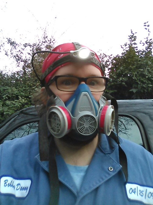 Robby in respirator for paint scraping